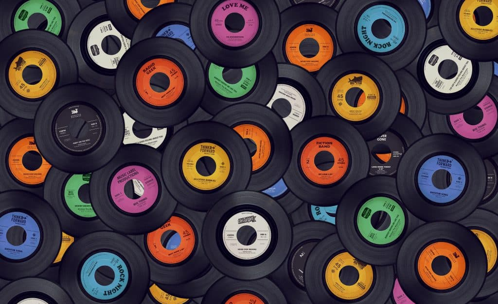 pile of vinyl records colorful labels retro music