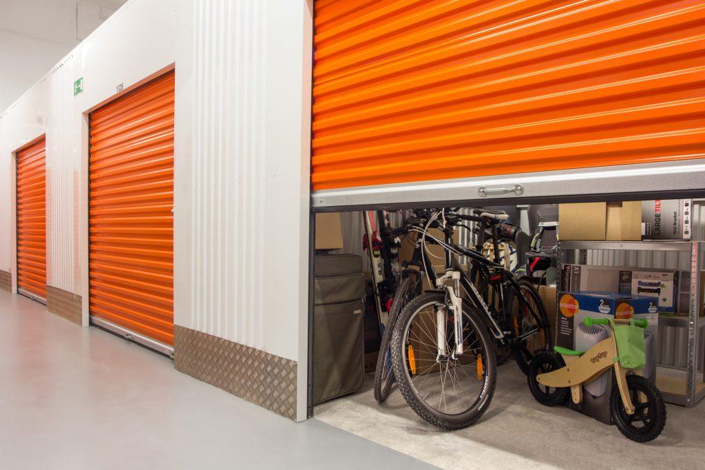 self storage unit orange doors with bicycles inside