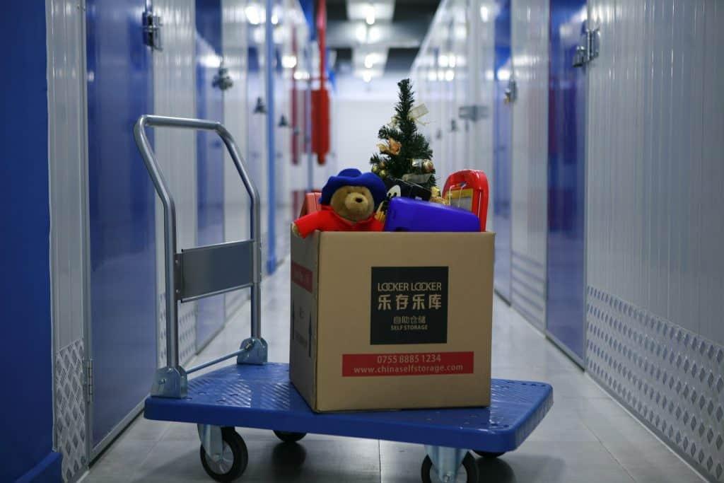 teddy bear christmas tree decorations in box storage facility hallway storage units