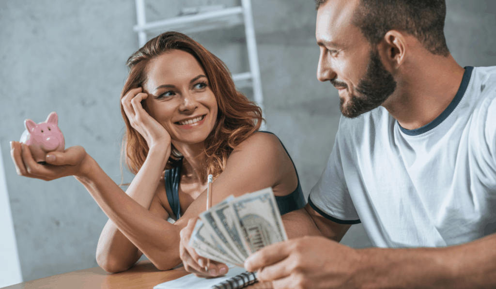 happy couple planning new apartment budget
