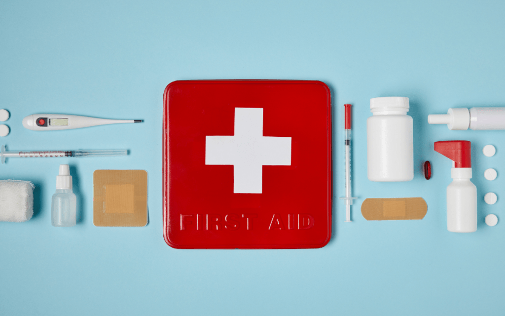 first aid kit flatlay on blue background
