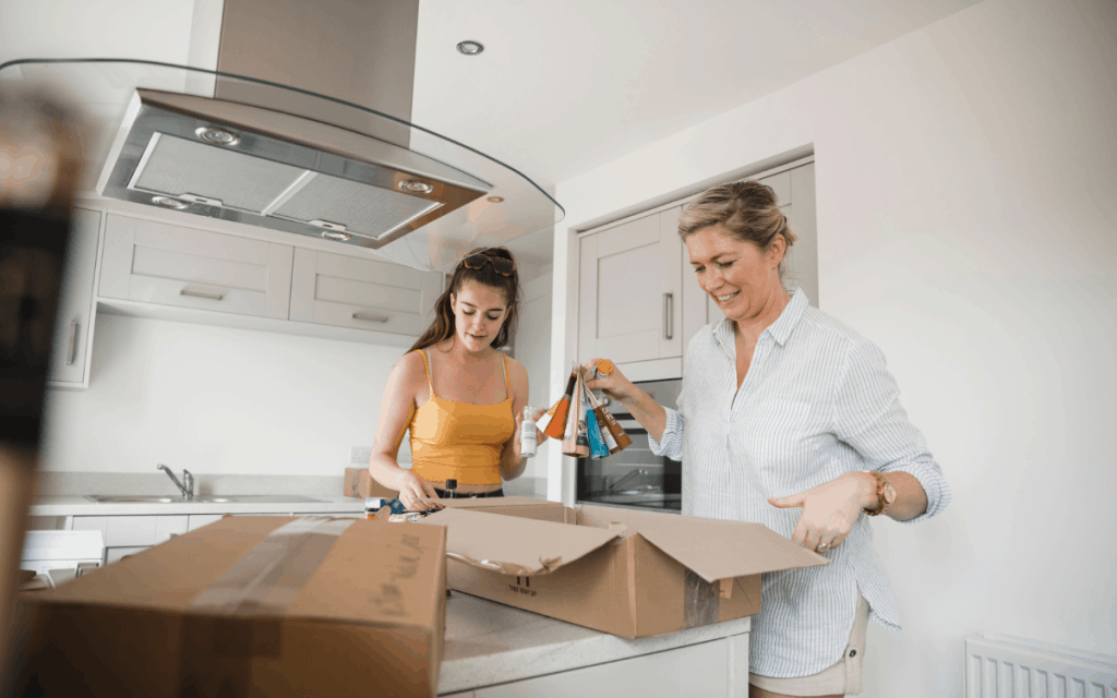 mother daughter unpacking supplies in new kitchen