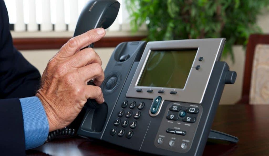 man picking up the phone
