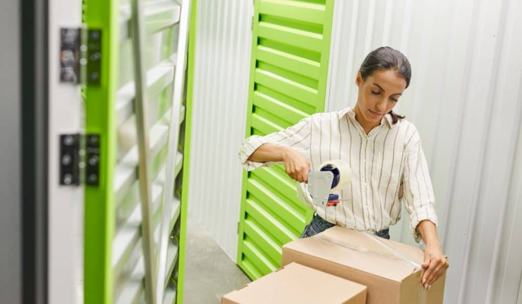 woman checking boxes to store at a storage facility unit